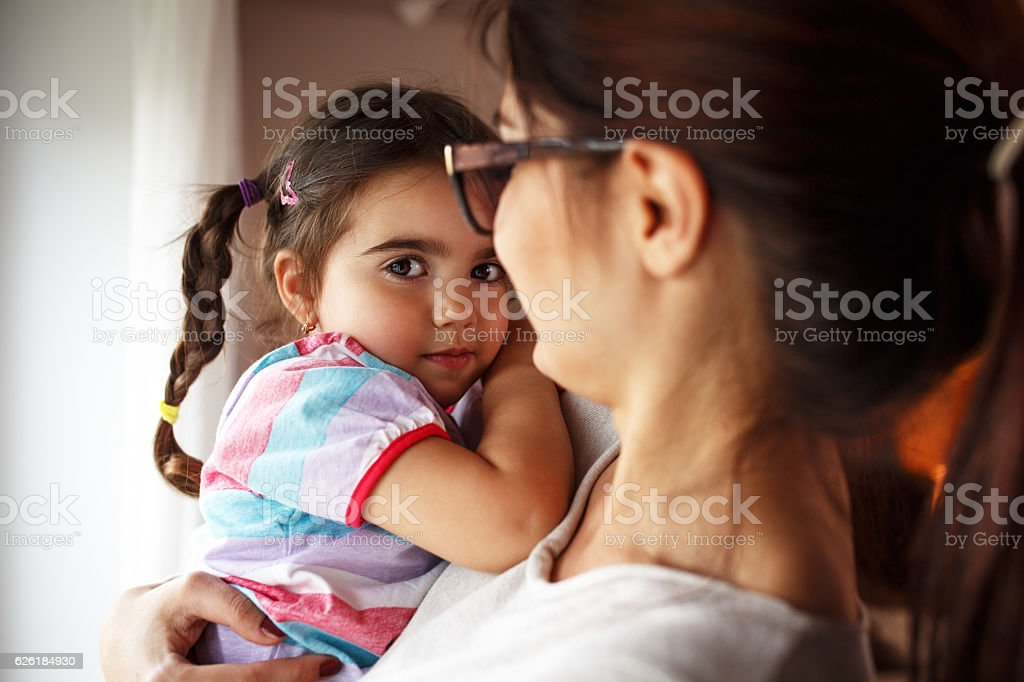 Mother holding her daughter. stock photo