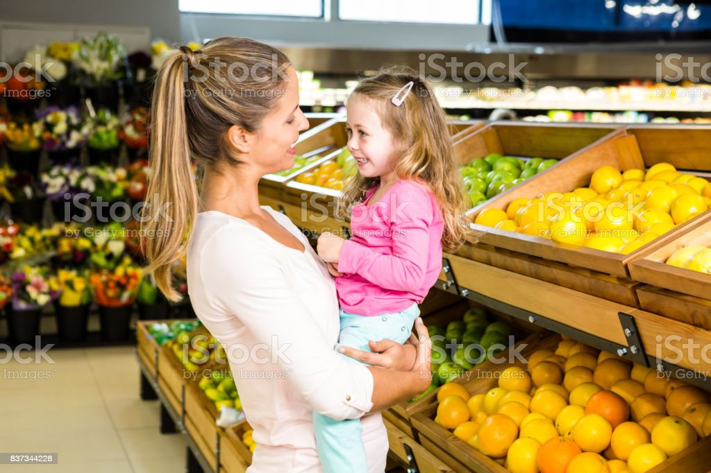 Mother holding her daughter stock photo