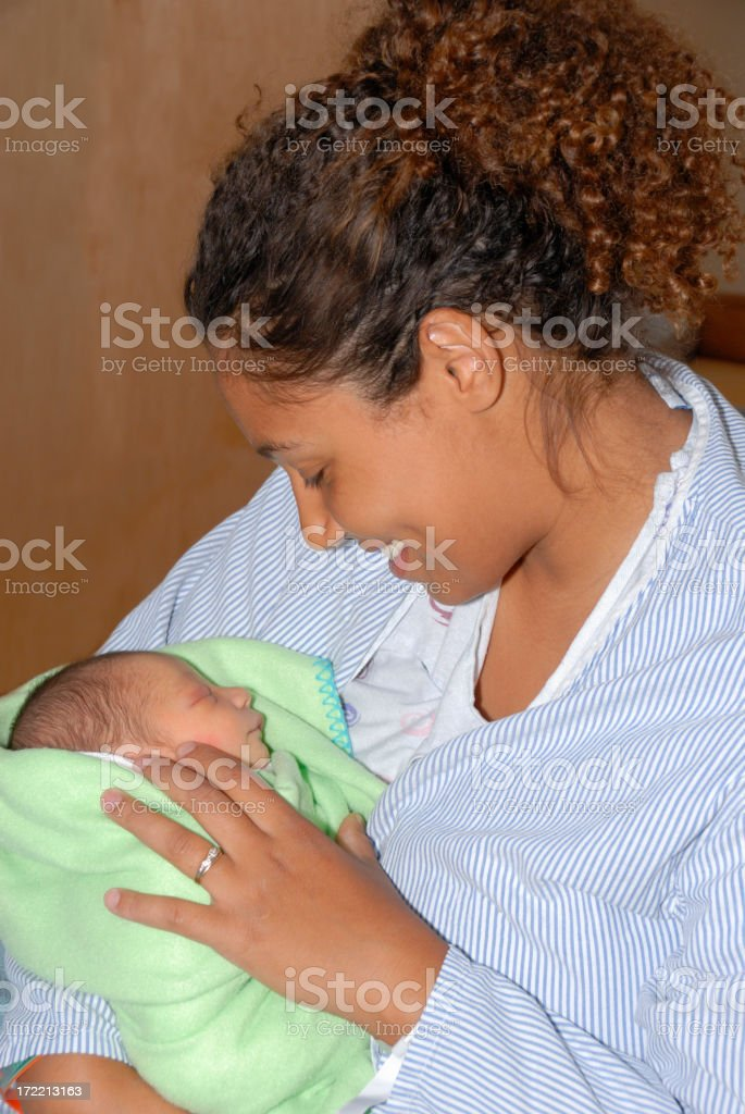 Mother Holding her Newborn Son stock photo