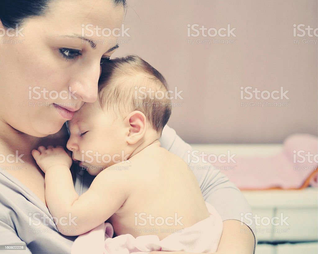 Mother Holding Her Sleeping Baby Girl royalty-free stock photo