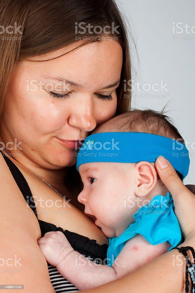 Mother holding newborn baby girl royalty-free stock photo