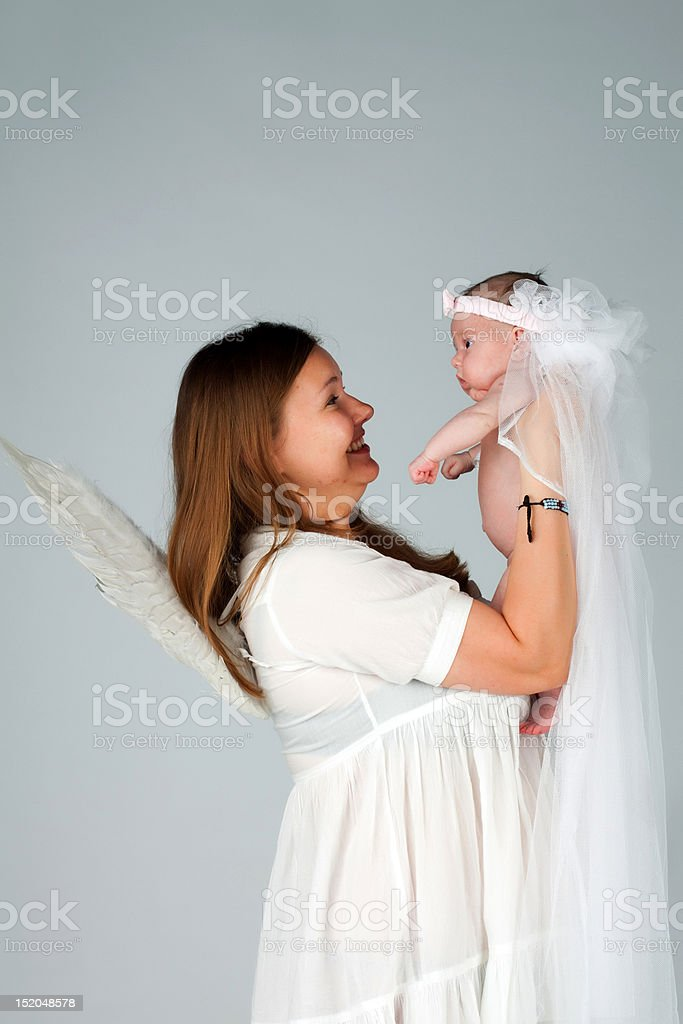 Mother holding newborn baby girl royalty-free stock photo