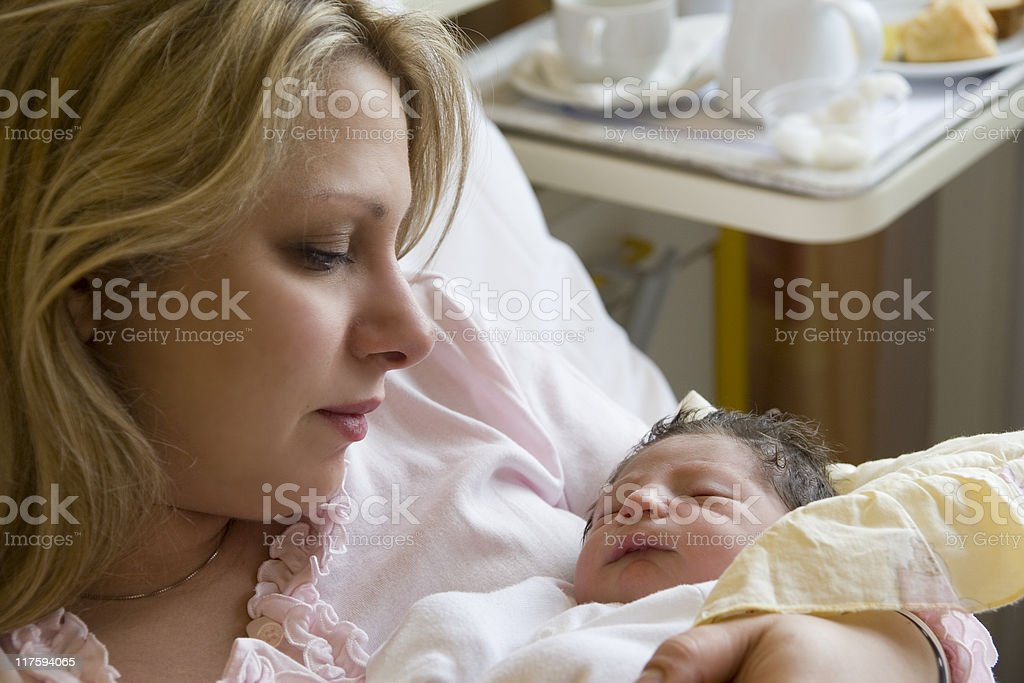 Mother holding newborn baby royalty-free stock photo