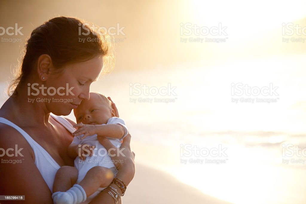 mother holding newborn child in her arms royalty-free stock photo