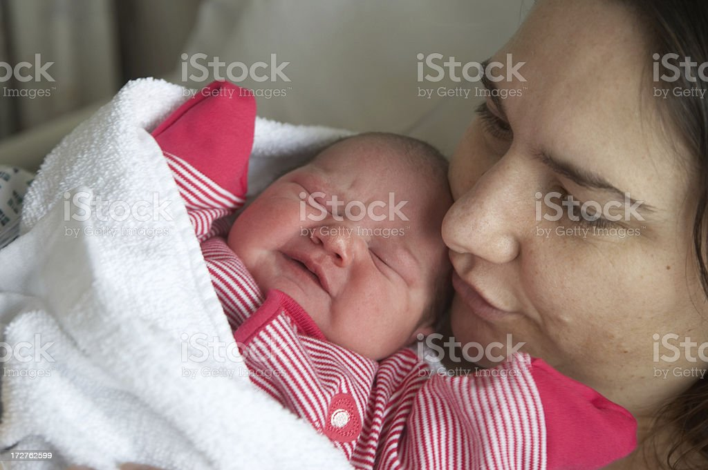 Mother holding newborn royalty-free stock photo
