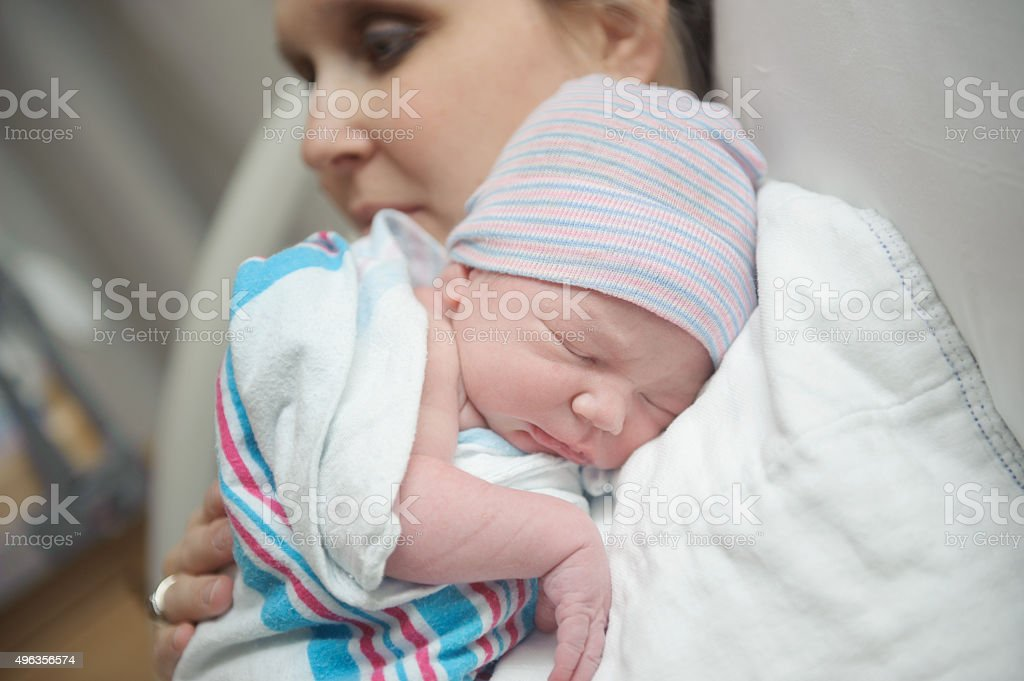 Mother Holding Newborn Son stock photo