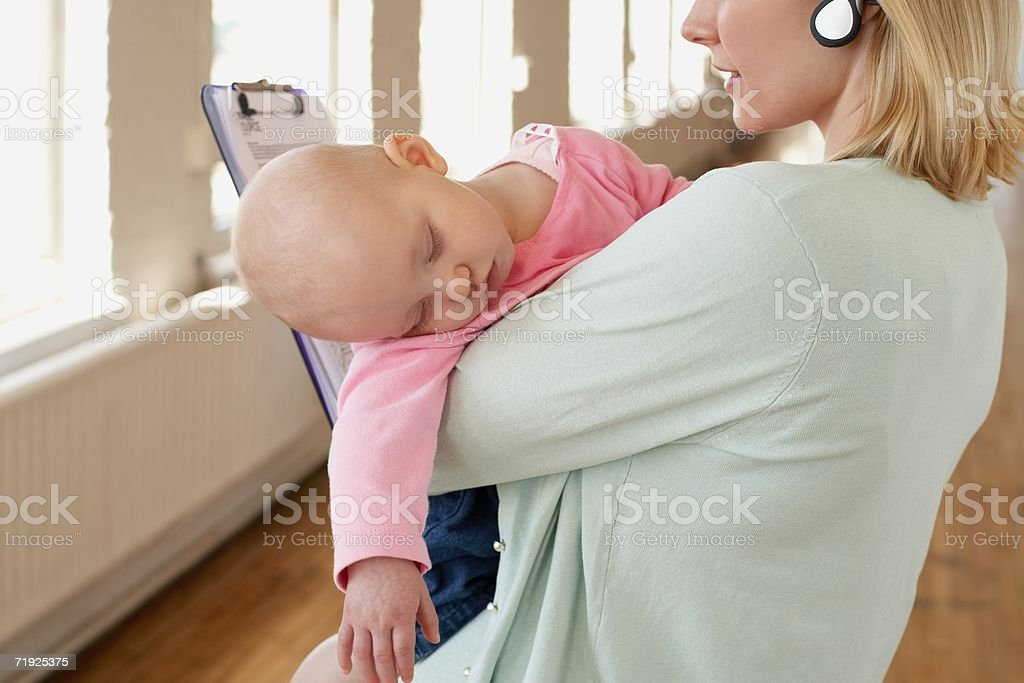 A mother holding sleeping baby royalty-free stock photo