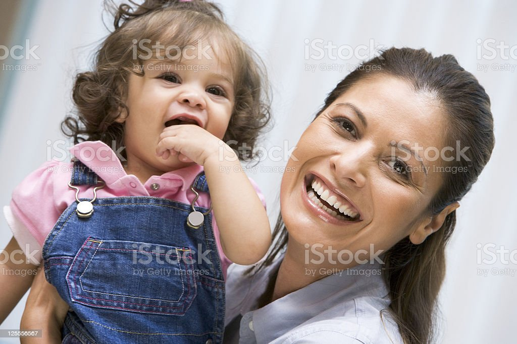 Mother holding young girl royalty-free stock photo