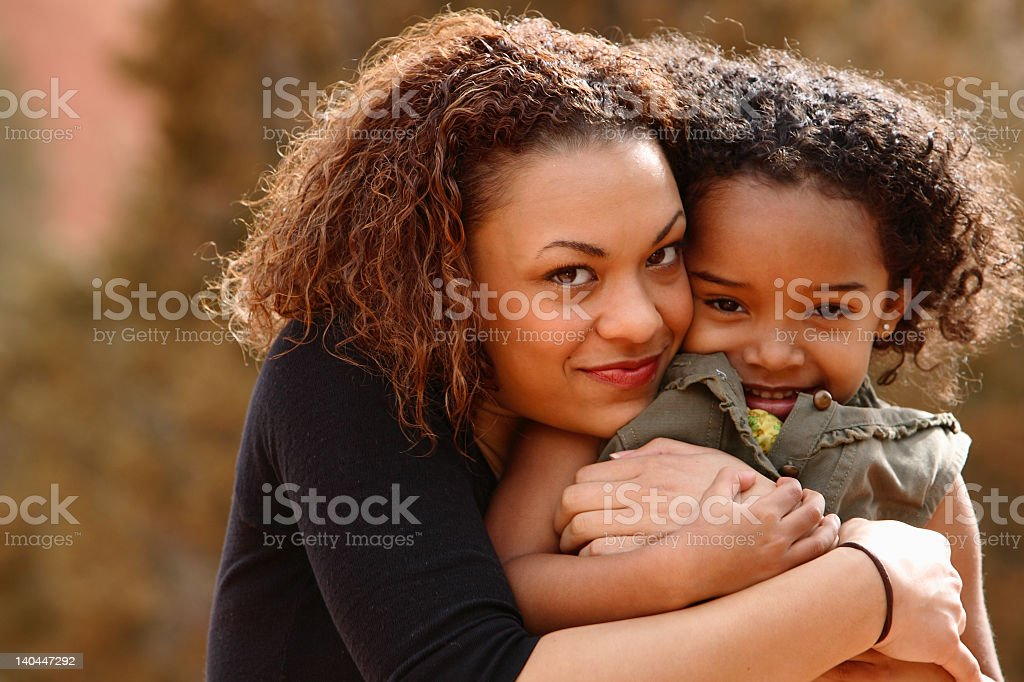 Mother hugging child on the mountains stock photo