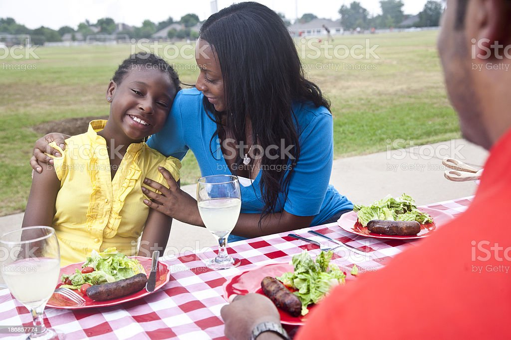 Mother Hugging Daughter at Family Picnic royalty-free stock photo