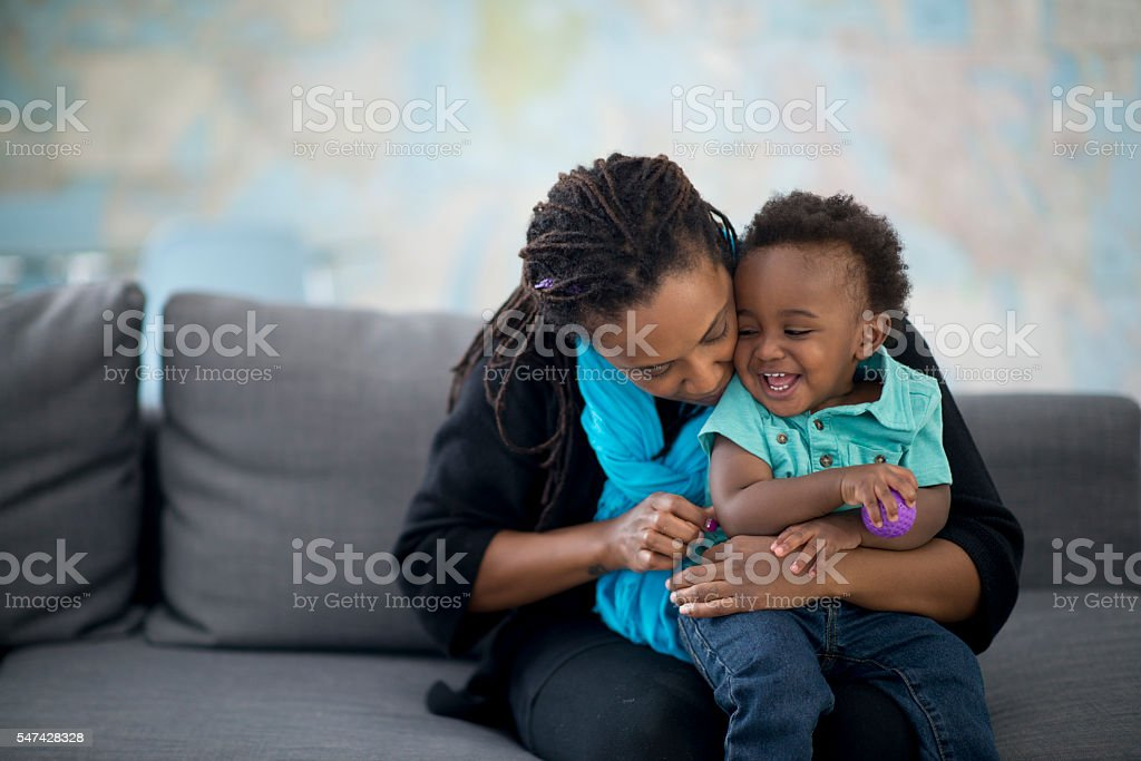 Mother Hugging Her Little Boy stock photo