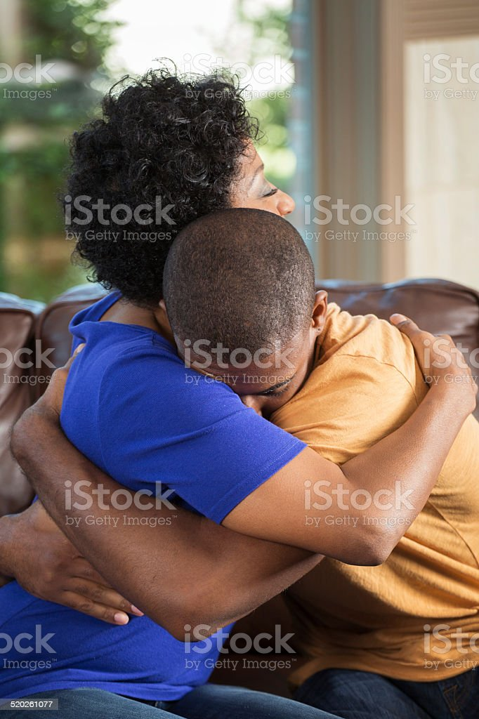 Mother hugging her son stock photo