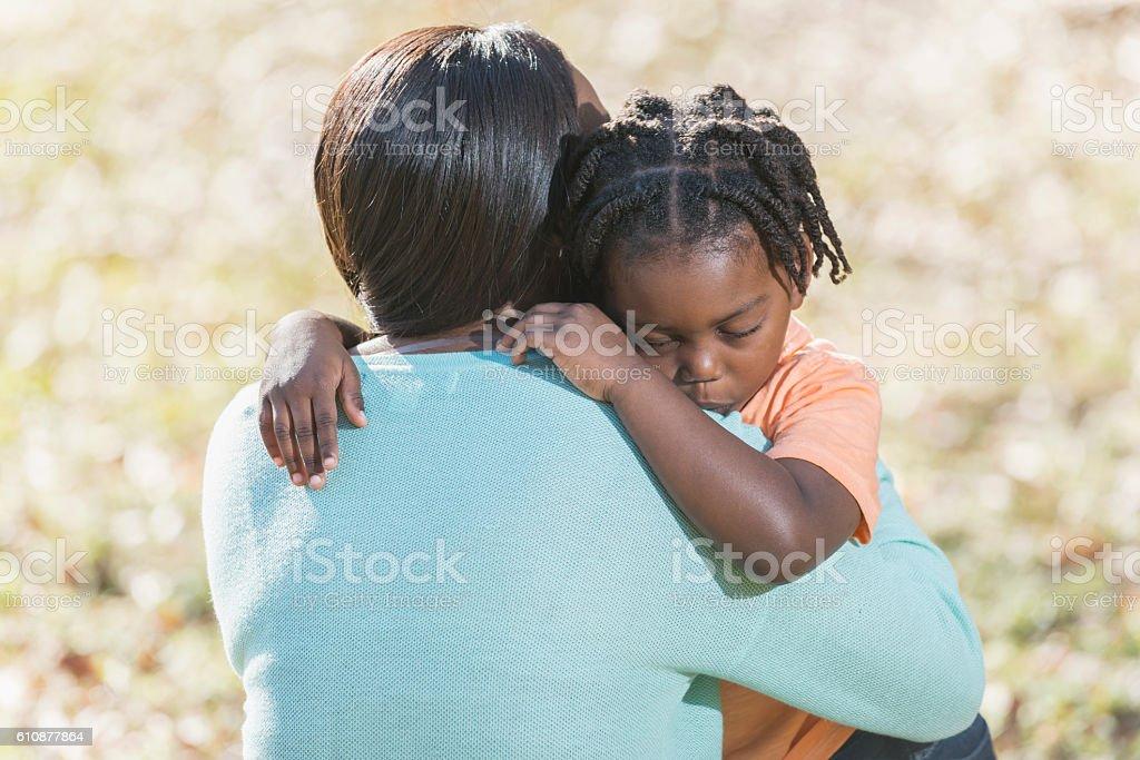 Mother hugging little boy stock photo