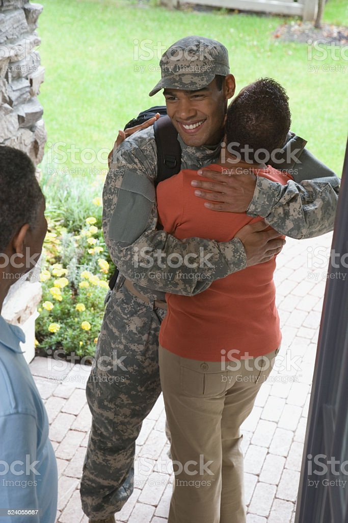 Mother Hugging Returning Soldier stock photo