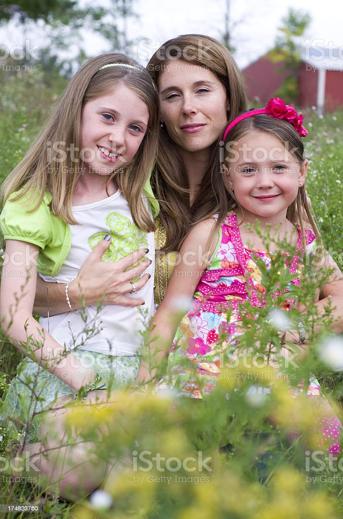 Mother hugs her two girls royalty-free stock photo