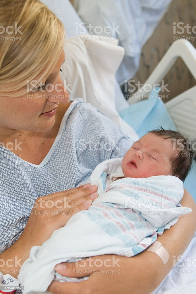 A mother in the hospital with her new born baby royalty-free stock photo