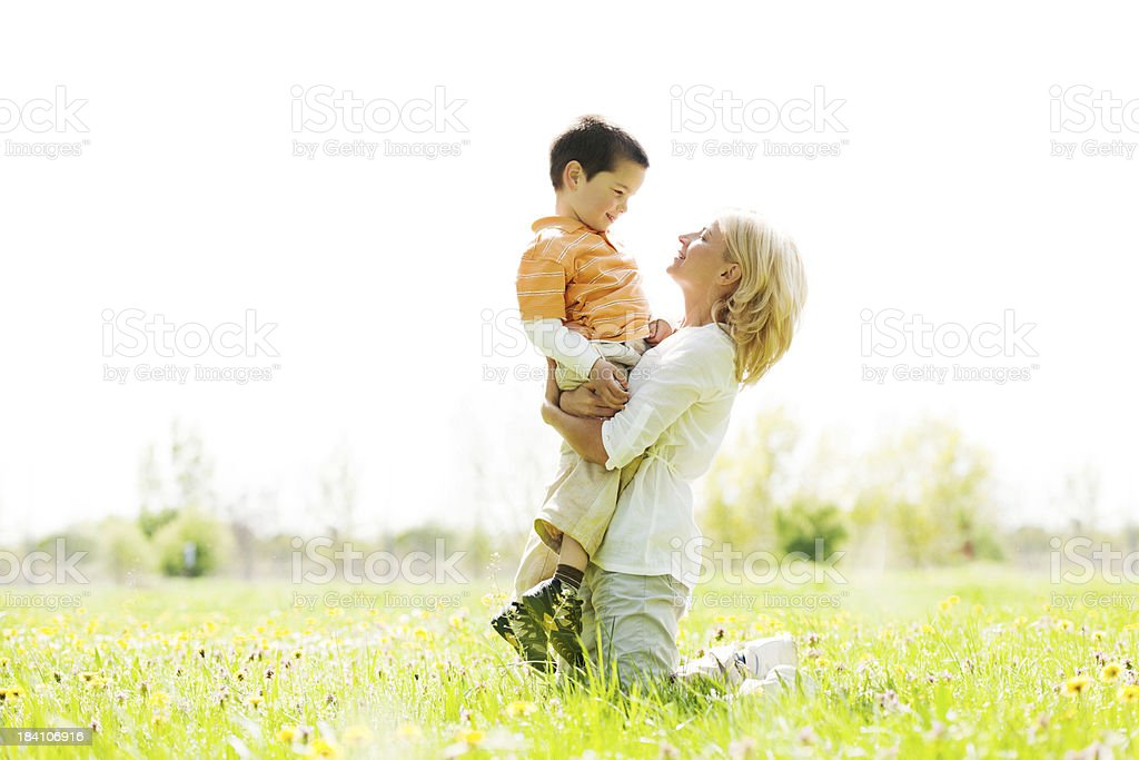 Mother is holding her son in the park. royalty-free stock photo