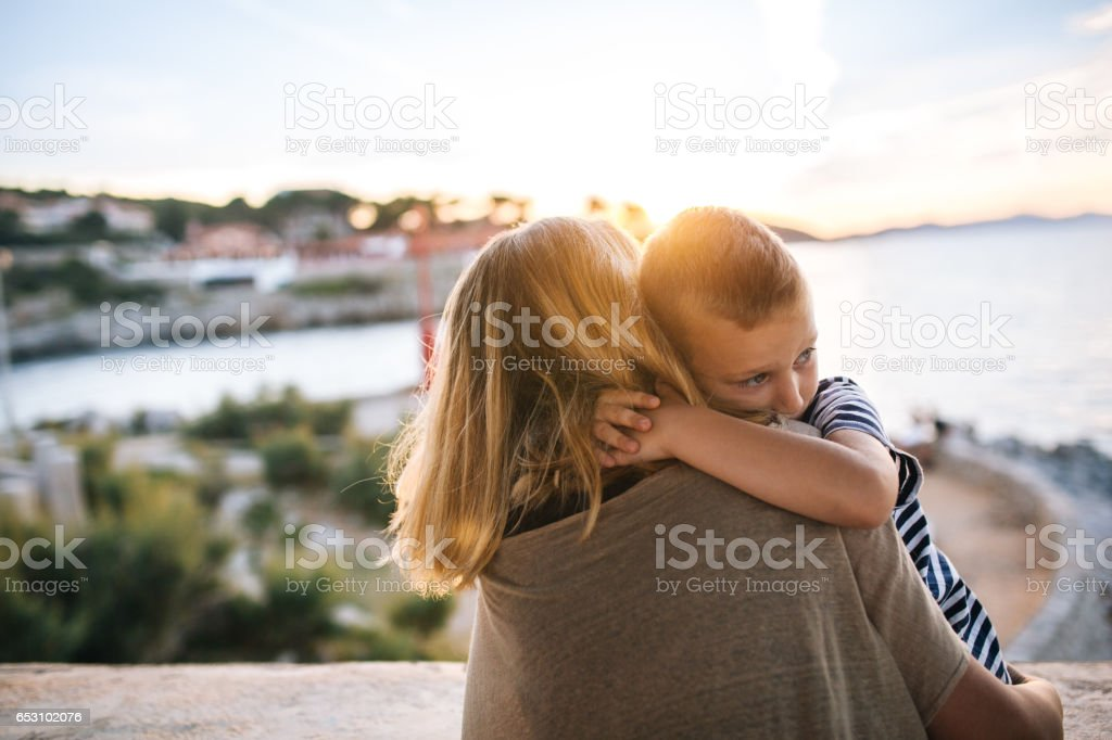 Mother is holding her son stock photo