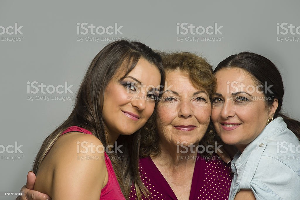 Mother is hugging her daughters royalty-free stock photo