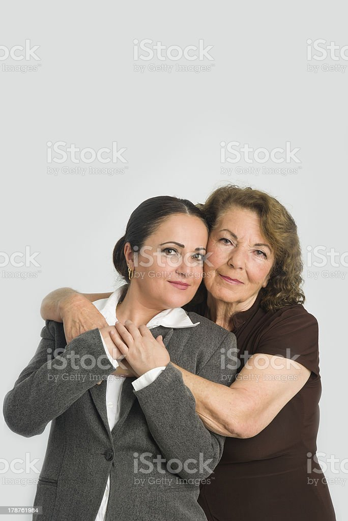 Mother is hugginng her daughter royalty-free stock photo