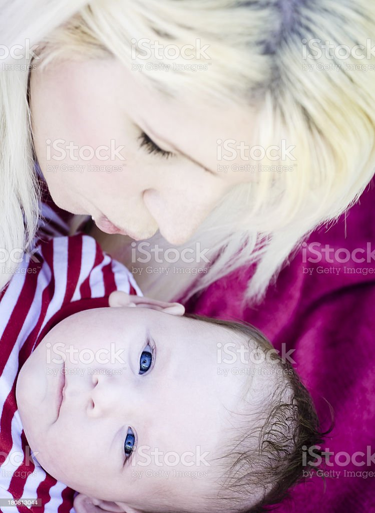 Mother Kissing a Baby royalty-free stock photo