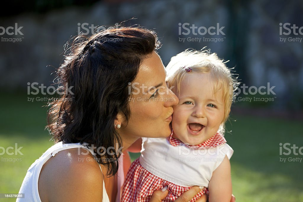 Mother kissing baby girl royalty-free stock photo