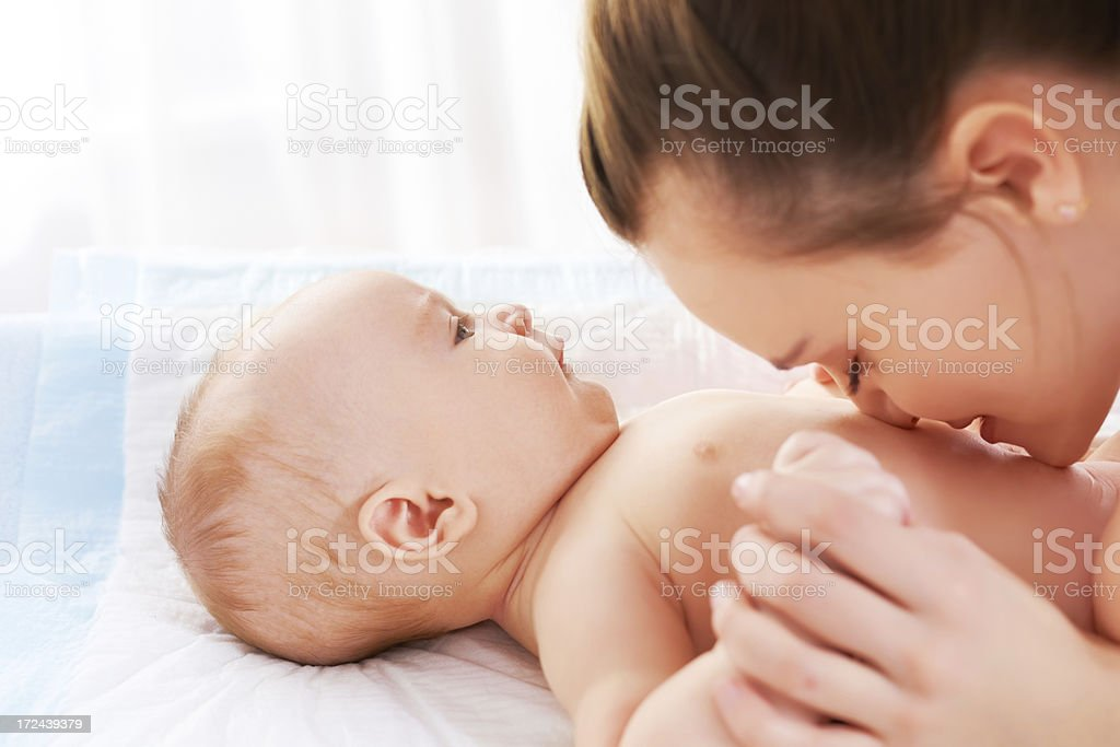 Mother kissing baby royalty-free stock photo