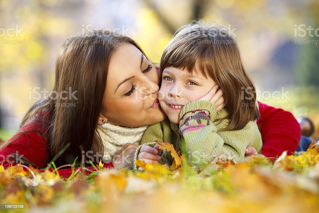 Mother kissing daughter royalty-free stock photo