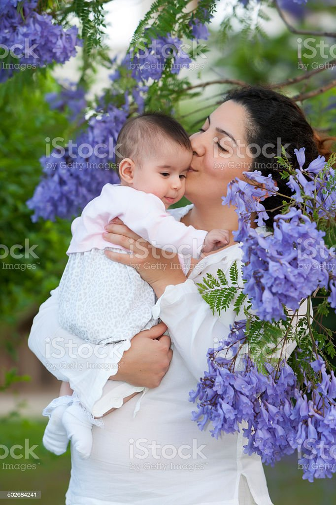 Mother Kissing Her Baby Girl royalty-free stock photo