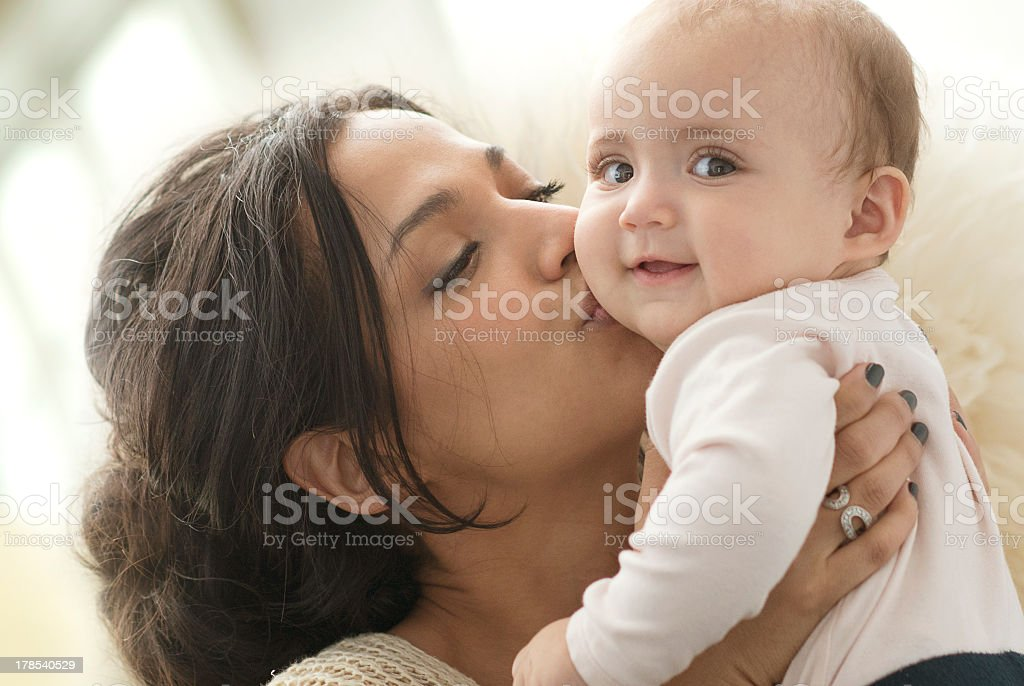 Mother kissing her beloved baby royalty-free stock photo