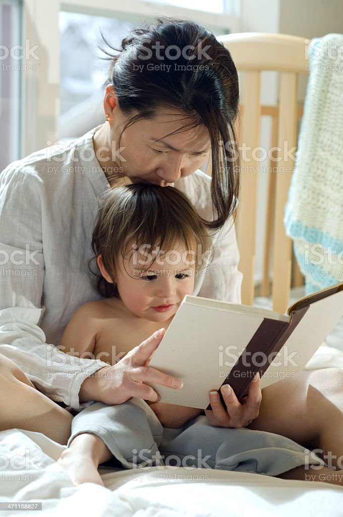 Mother kissing son while Reading a Story royalty-free stock photo