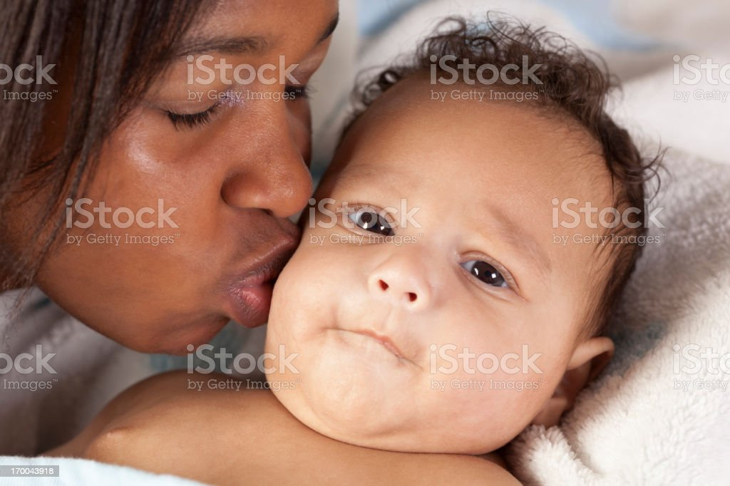 Mother Kissing Young Baby royalty-free stock photo