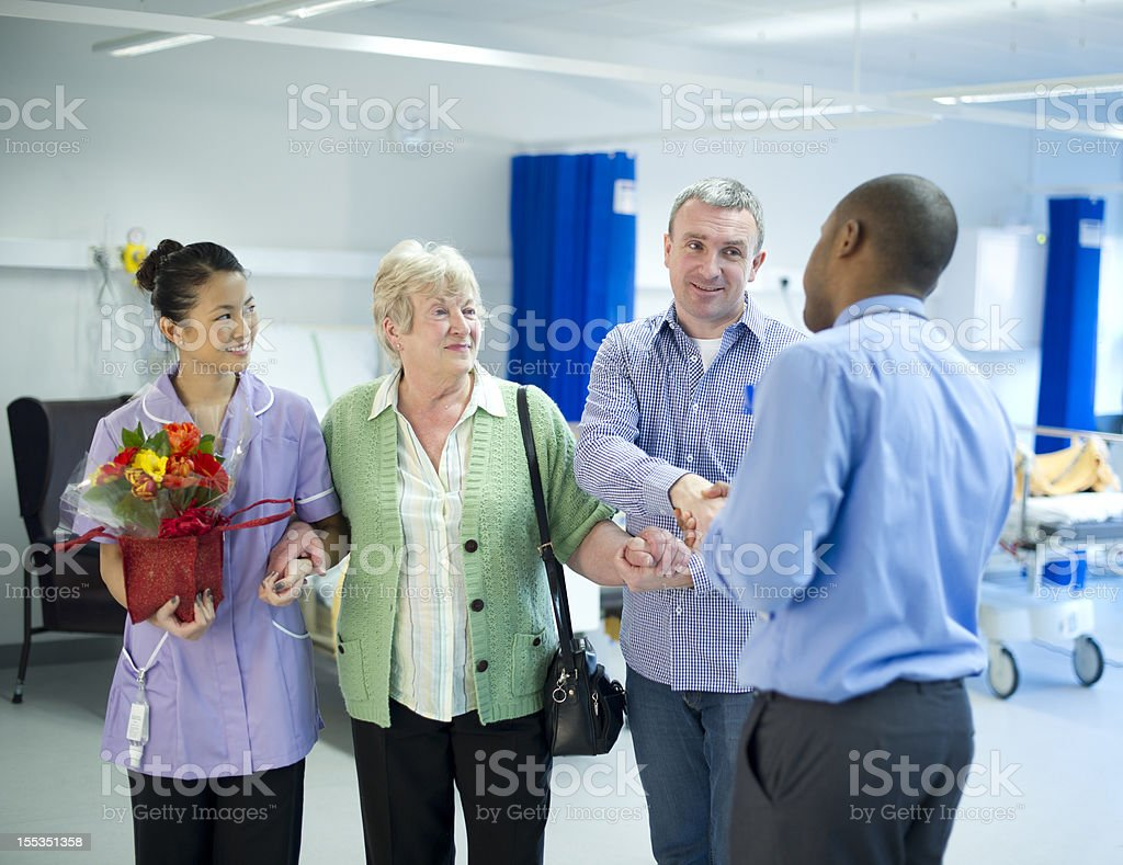 mother leaves hospital royalty-free stock photo