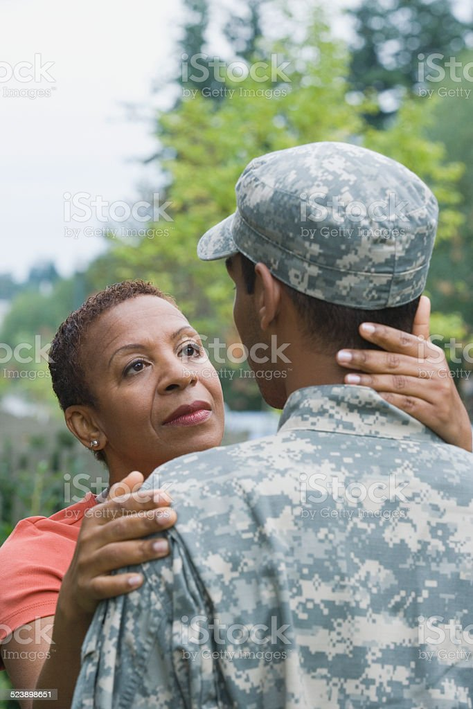 Mother Looking at Soldier stock photo