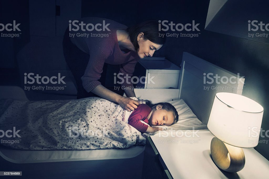 Mother lulling her daughter stock photo