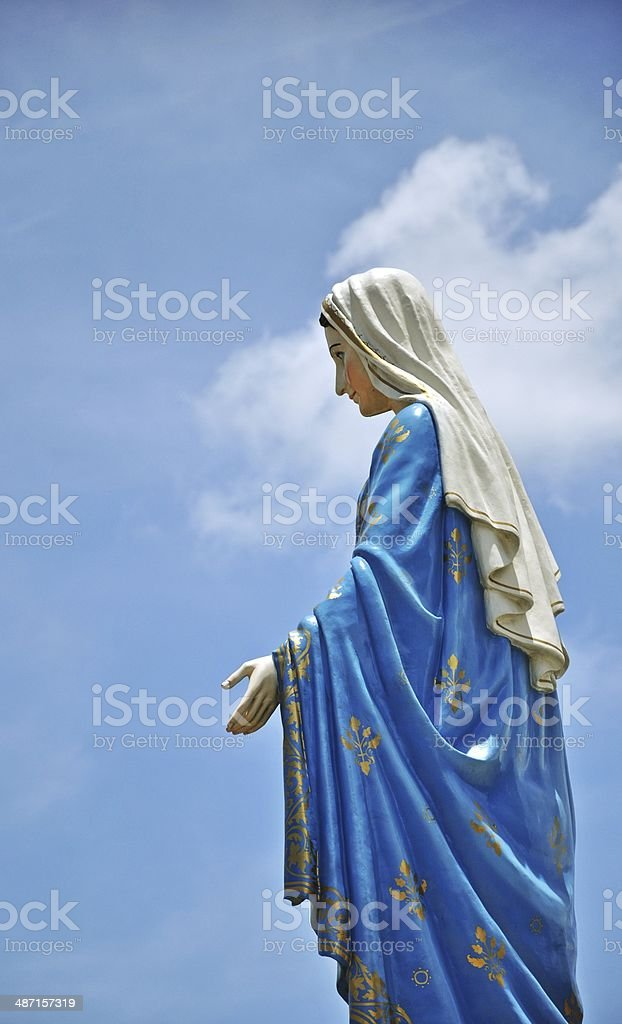 Mother mary statue on blue sky royalty-free stock photo