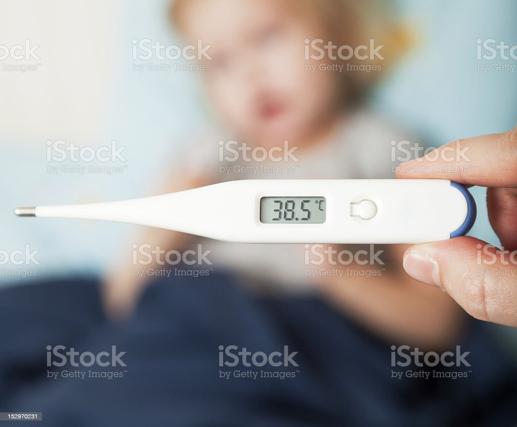 mother measures the temperature of her daughter stock photo