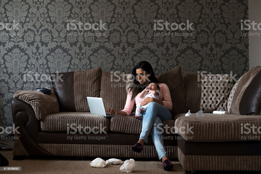 Mother multi-tasking work and son stock photo