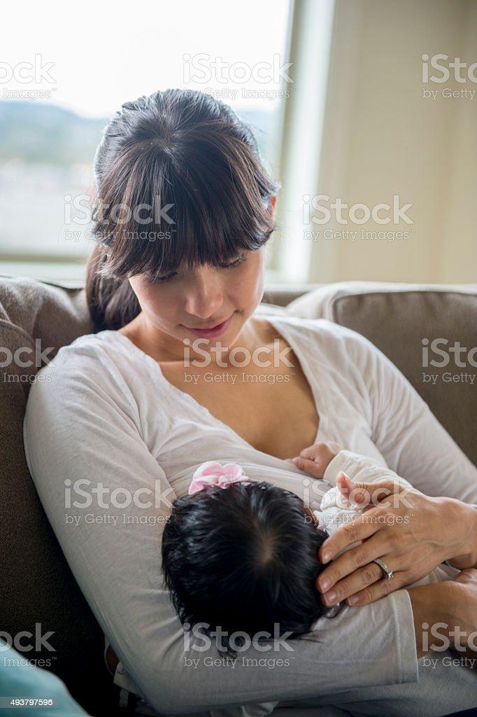 Mother Nursing Her Baby stock photo