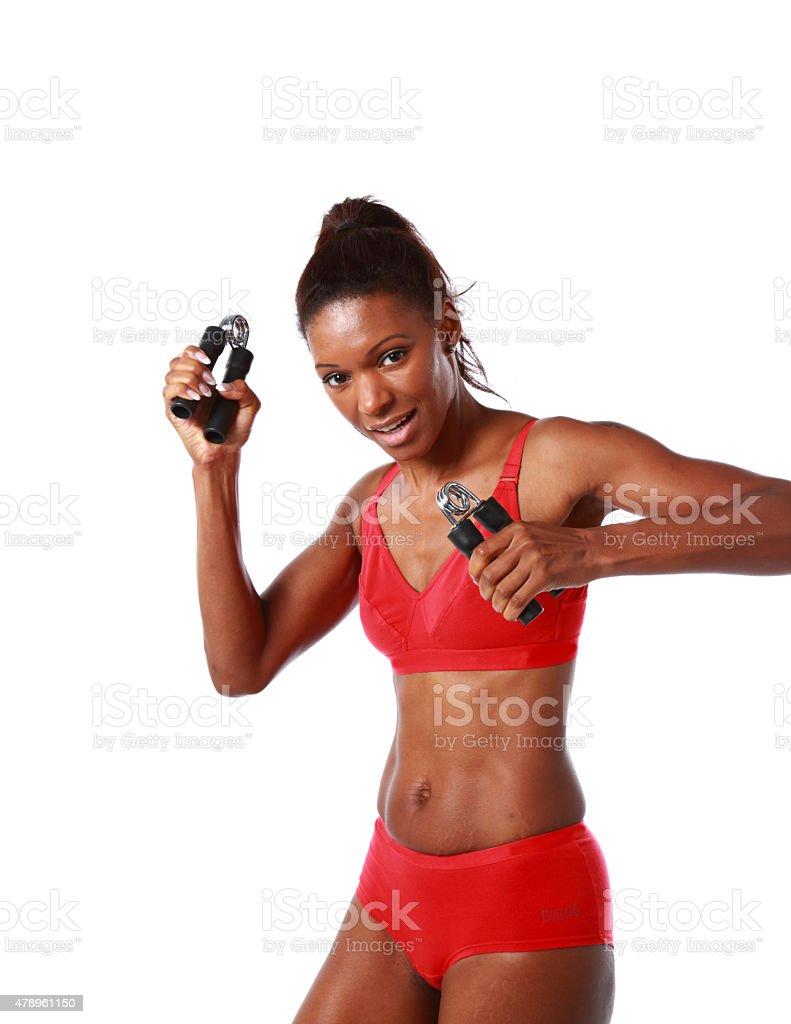 mother of 4 working out with hand grips-isolated on white stock photo