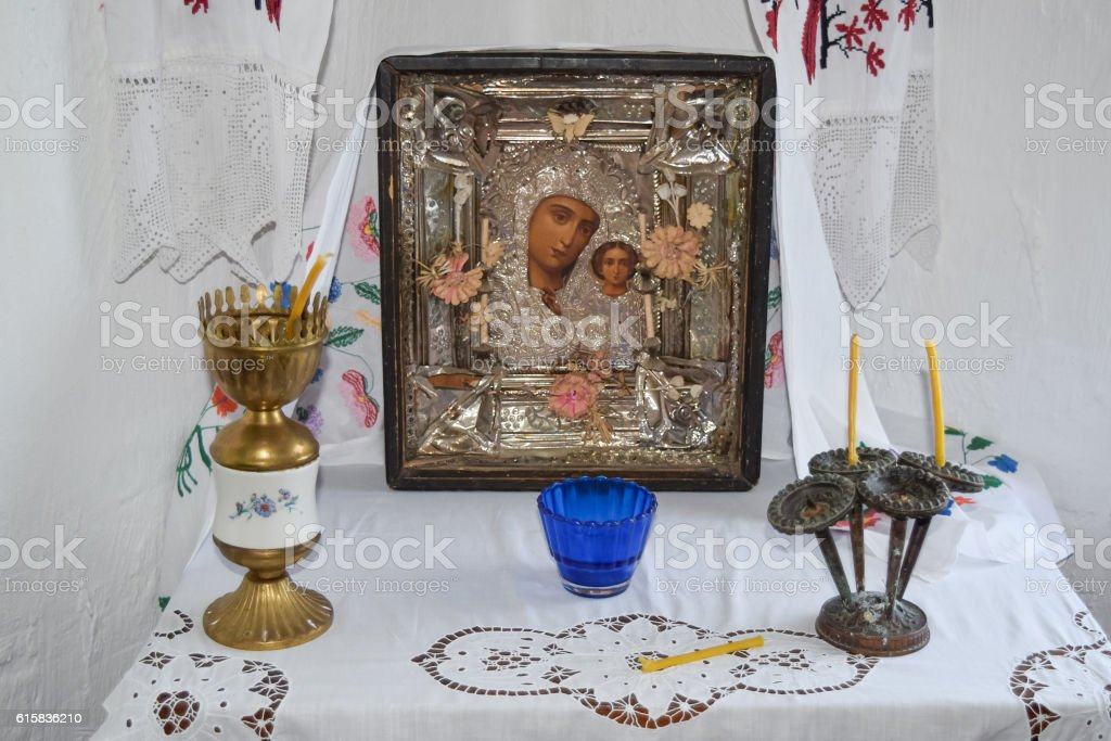 Mother of God and candles in candlesticks on the table. stock photo