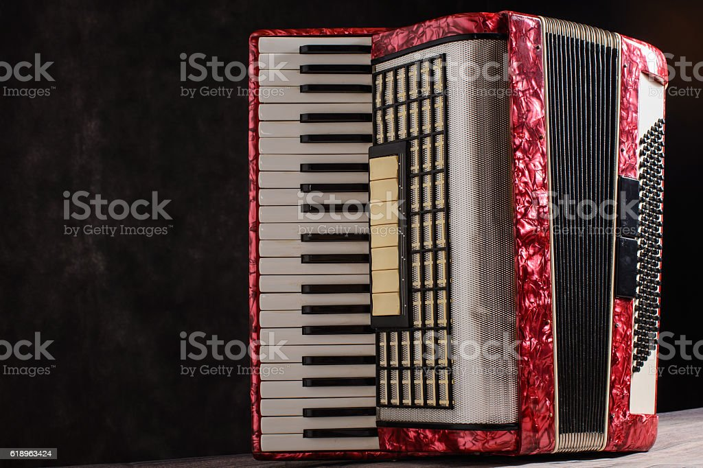 Mother of pearl accordion on a black background stock photo