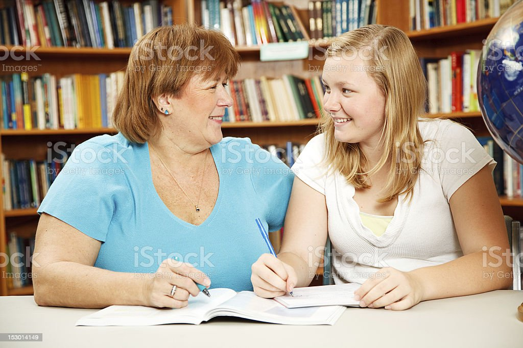 Mother or Teacher with Teen Student stock photo