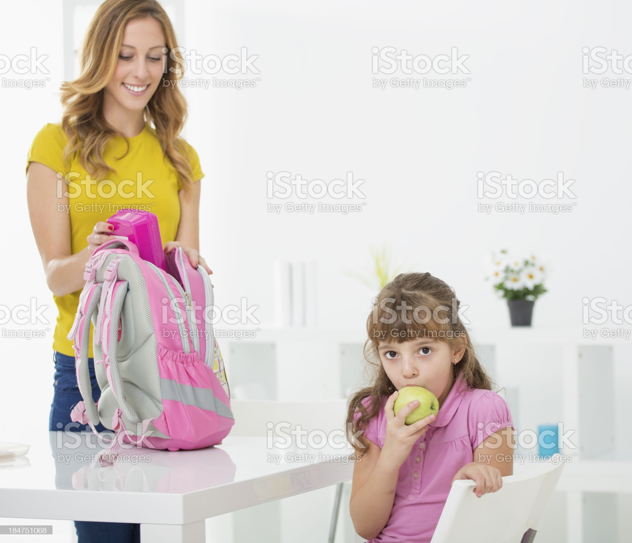 Mother packing snack for her school girl. royalty-free stock photo