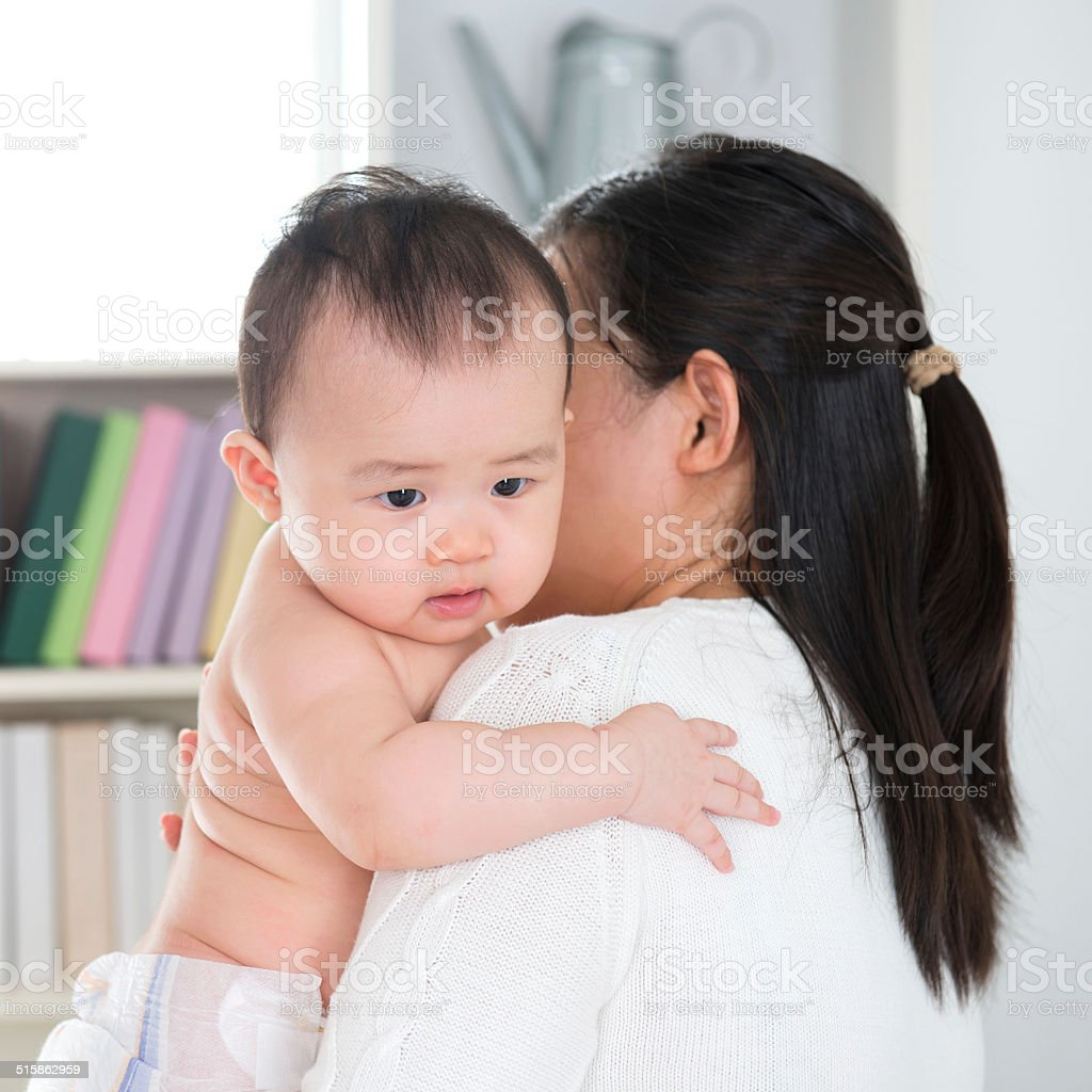 Mother pampering baby stock photo