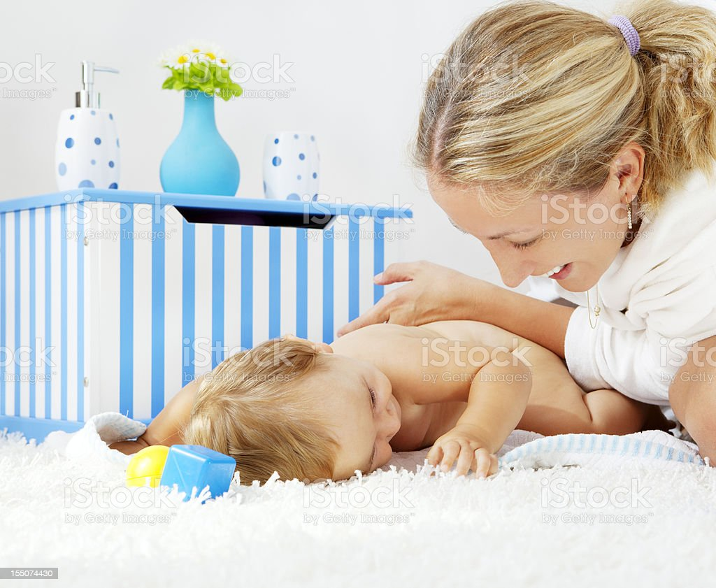 Mother pampering her baby girl daughter after bath royalty-free stock photo