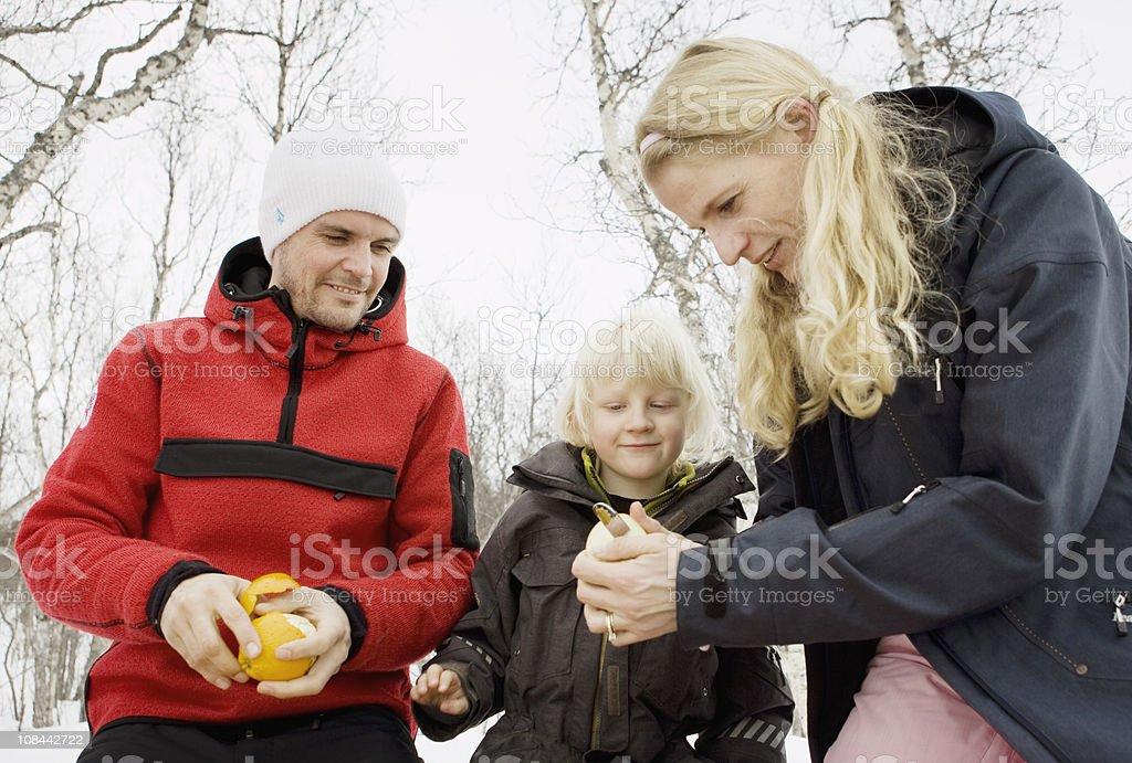 Mother peeling fruit stock photo