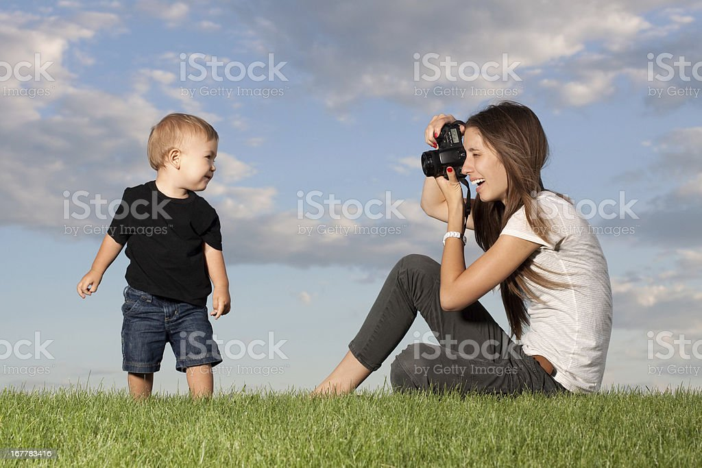 Mother Photographer Taking Picture of Child royalty-free stock photo