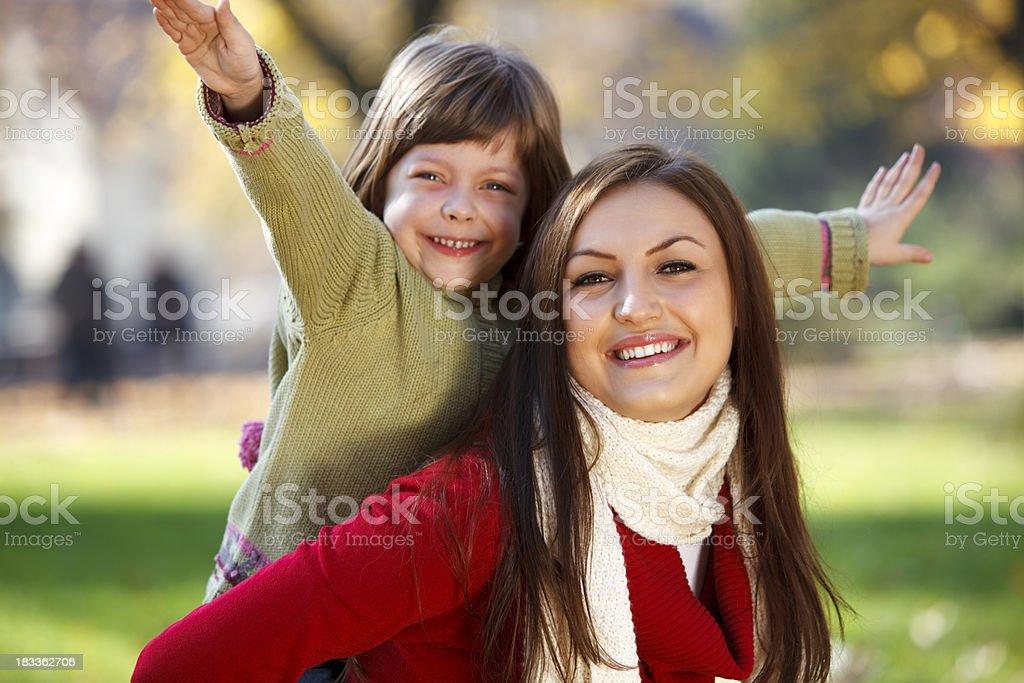 Mother piggybacking her daughter royalty-free stock photo