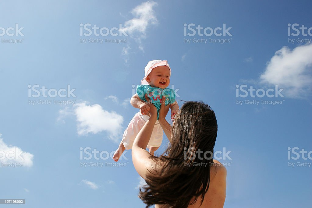 mother playing with baby in the sky royalty-free stock photo